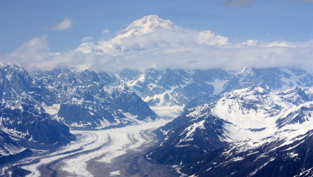 Flying northward over the Tokositna Glacier gives views of Mount McKinley, North America's highest mountain, towering over surrounding peaks of the Alaska Range.