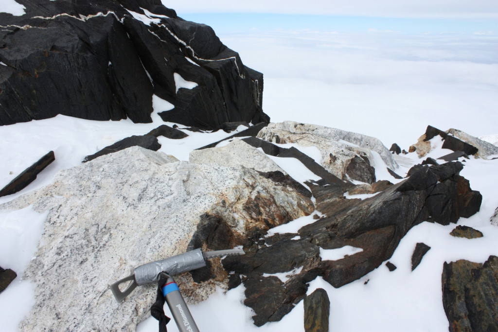 Just above Denali Pass (18,200 feet; 5,500 m) on Mount McKinley's West Buttress are the Zebra Rocks, named for their black-and-white striped appearance. The white rocks are late-stage felsic (silica-rich) igneous dikes associated with the McKinley Granite. The black rocks are Cretaceous marine siltstone and shale that were metamorphosed to argillite by the heat of the McKinley Granite intrusion.