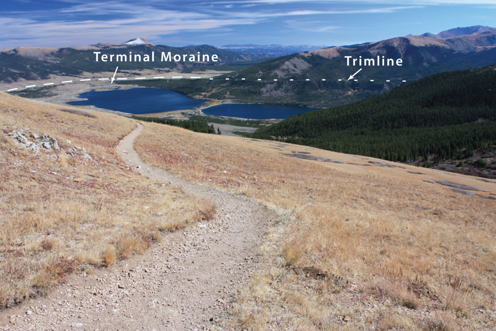 The view southeast from the South Mount Elbert Trail shows Twin Lakes, which occupy a natural basin in the terminal moraine complex of the Lake Creek glacier. The glacier's trimline is visible on the far side of the Lake Creek valley, marking the upper limit of glacial ice.